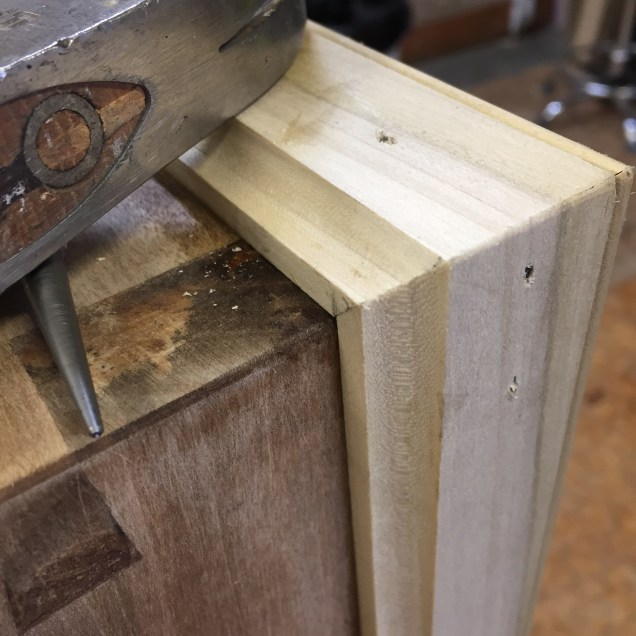 Nailing through the miters .. w/o splitting the molding. :)