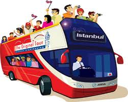 """A crowded sightseeing bus on a busy street..."""