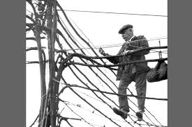 """""""Telephone linemen at work installing new connections; the need to establish new channels of communication"""""""