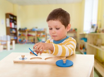 Young Boy in Montessori Classroom