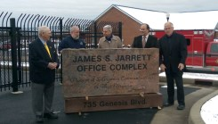 An impressive monument was unveiled last Thursday, naming the new Harrison/Taylor E-911 Office Complex in honor of Shinnston resident Jim Jarrett. Pictured here (l-rt) are: Jim Jarrett, 911 Administrator Paul Bump, former Harrison County Commissioner Bernie Fazzini, and Commissioners David Hinkle and Ron Watson.