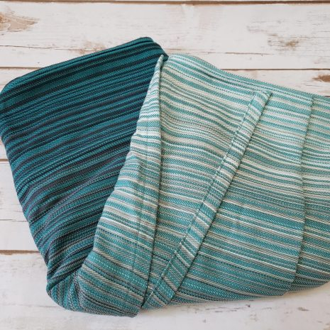 butterfly_baby_co_serenity_teal_monochrome_teal_turquoise_budget_low_cost_woven_wrap_babywearing_ring_sling_wrap_conversion_shiny_tar_designs_america