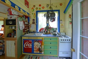 The kitchen consists of a sink and stove. The fridge and food/dish cupboards are housed in the living room.