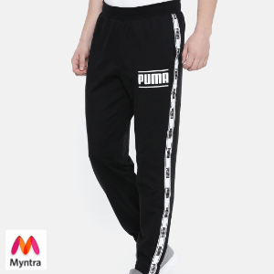 4d7888bd84 Buy Puma Men Black Solid Camo Pack Tape Joggers from Myntra and get it  shipped to Wellington