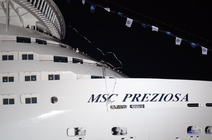 The bottle smashes against the starboard bow to name MSC Preziosa