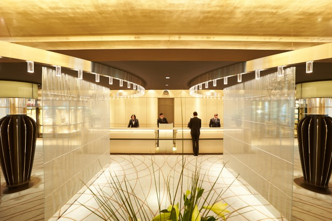 Cool reception: The welcome desk area on Europa 2 looks like 'a contemporary lifestyle hotel' says Hapag-Lloyd