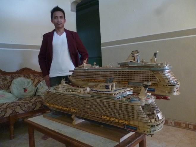 Proud: Humaini with his models (Picture: Humaini/Sakera Bambu)