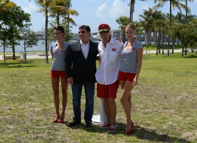 Sir Richard Branson and Virgin Cruises president and CEO Tom McAlpin raise the flag in Miami (PRNewsFoto/Virgin Cruises)