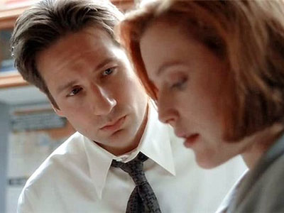 Mulder gazes at Scully