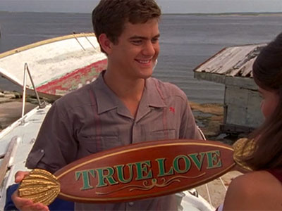 Pacey holds a True Love plaque