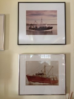 Photos of Reidar's vessels in the family kitchen.