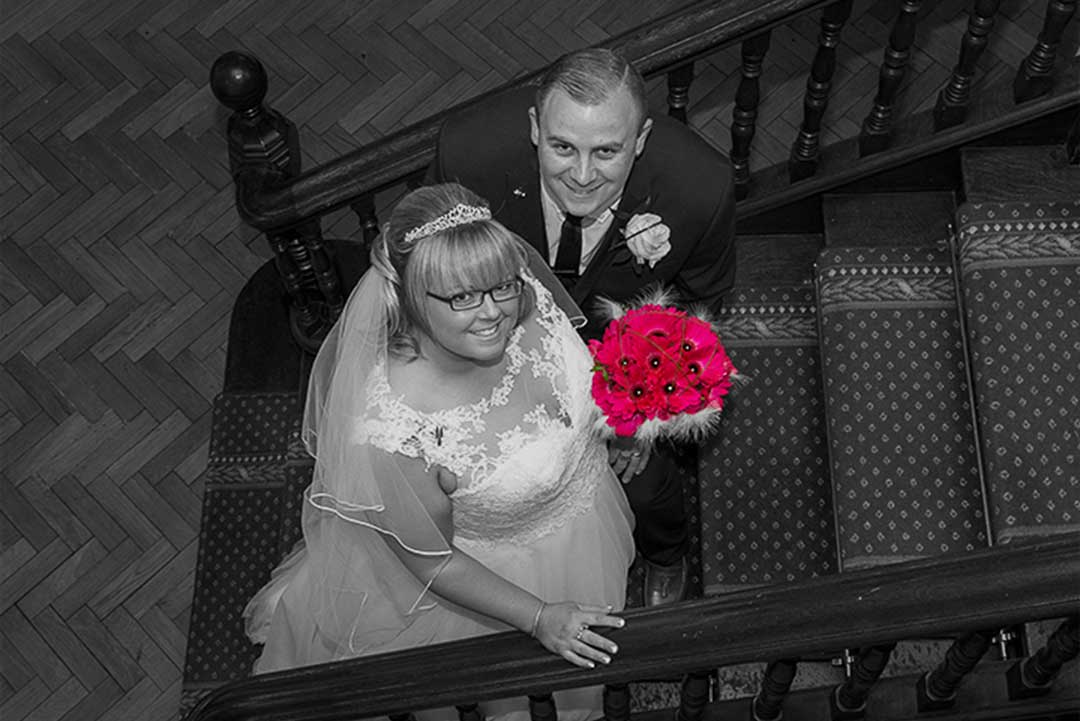 Bride and Groom on the stairs at Langtons House Hornchurch