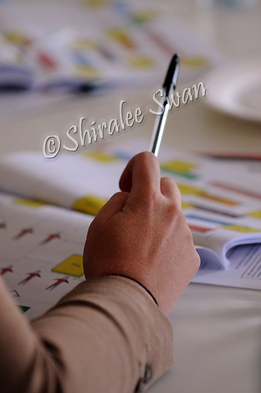 close up hand holding a pen