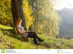 woman-looking-laptop-park-quiet-autumn-forest-34964830[1]