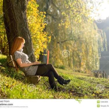 woman-looking-laptop-park-quiet-autumn-forest-34964830[1]