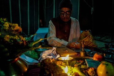Pandit ji performs Lakshmi Puja at home and is considered a close member of our family. Devotees show reverence to the goddess Lakshmi by placing oil lamps and candles inside and outside their houses. Prayers for good health and prosperity. India, Diwali 2015