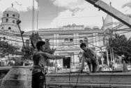 Men at work. Two men work across the Santa Cruz Church in old Manila. It was established by the Jesuits in the early 17th century. The facade was originally Baroque but has seen numerous changes through the years. The Philippines is the only predominately Christian nation in Asia. January 2016