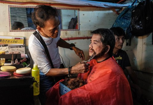 The volunteer make-up artist has been working with the Cenaculo of Malibay for three decades. He assists Mr. Jun Taytay, who plays Jesus.