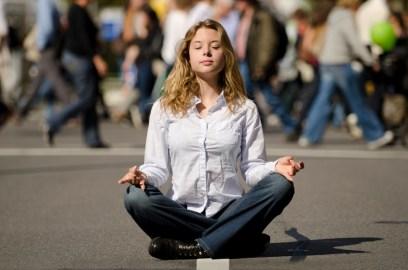 woman meditating on the street