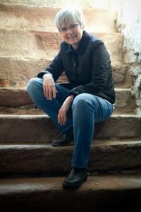 Smiling on archcellar steps