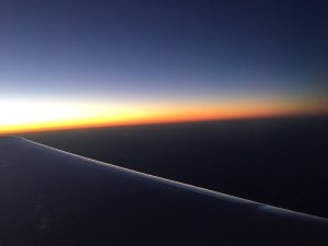 Sunrise on the wing of the airplane on the way to the South.