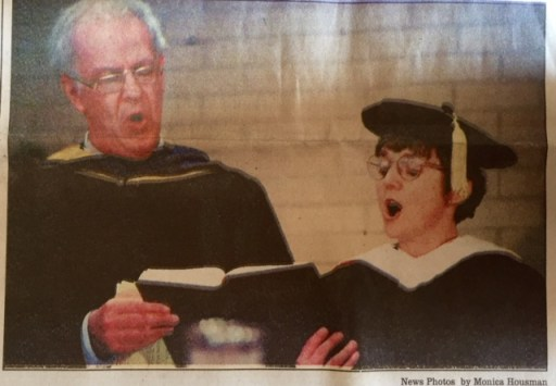 Sharing a hymnbook at my Goshen College inauguration, April 5, 1997.