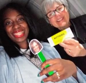 Attorney Stephanie Morales holds her Kamala swag while I brandish my LJC dinner ticket.