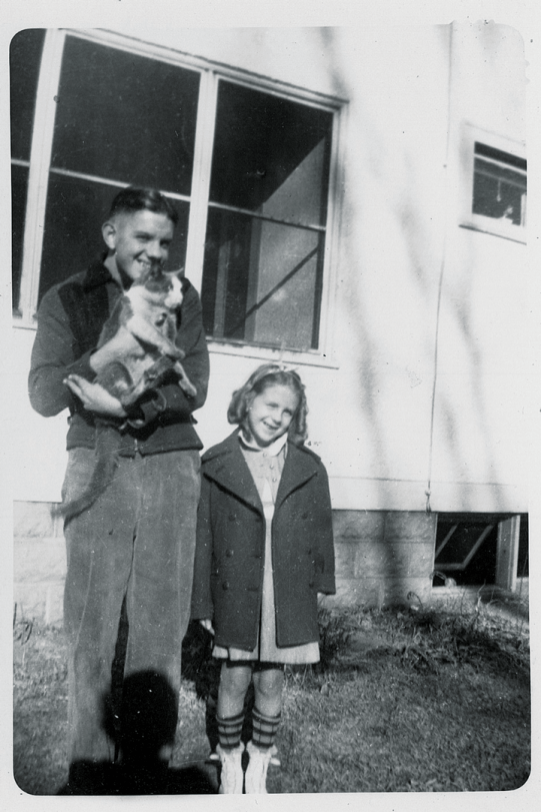 Shirley and her big brother, Bud, in front of their house in Marshalltown, Iowa.