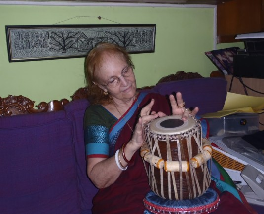 Dr. Harrison playing with the new tabla, getting lost in the sound.