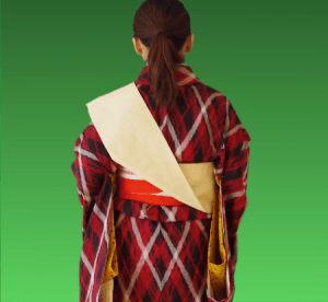 帯を肩にかける2