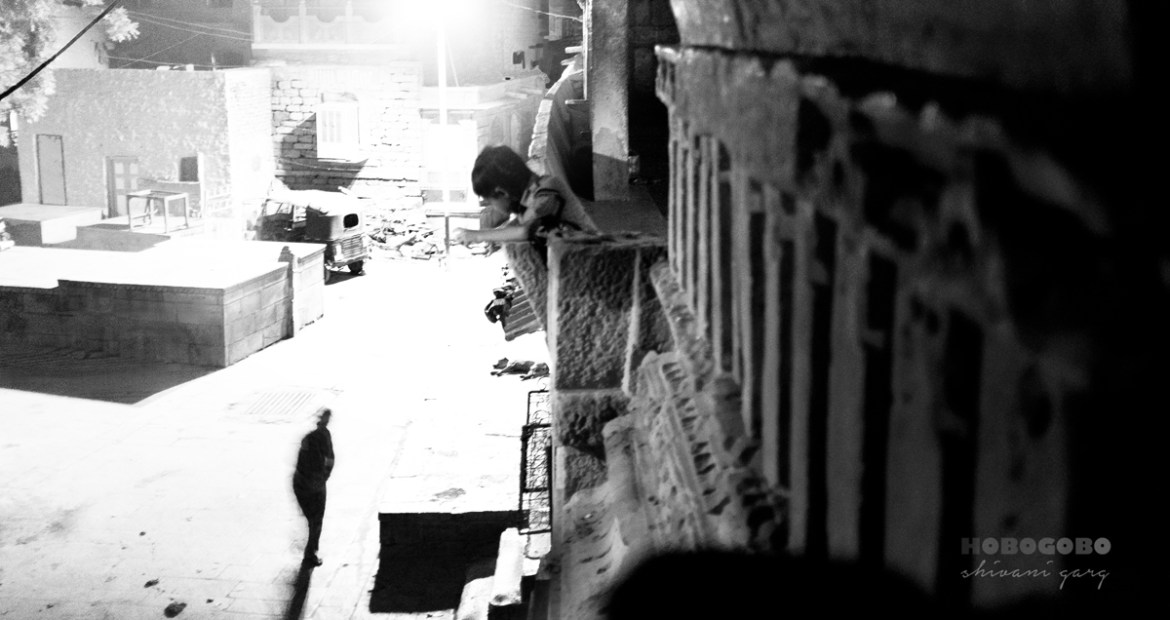Little boy looking out of a window of a hindu temple in Jaisalmer