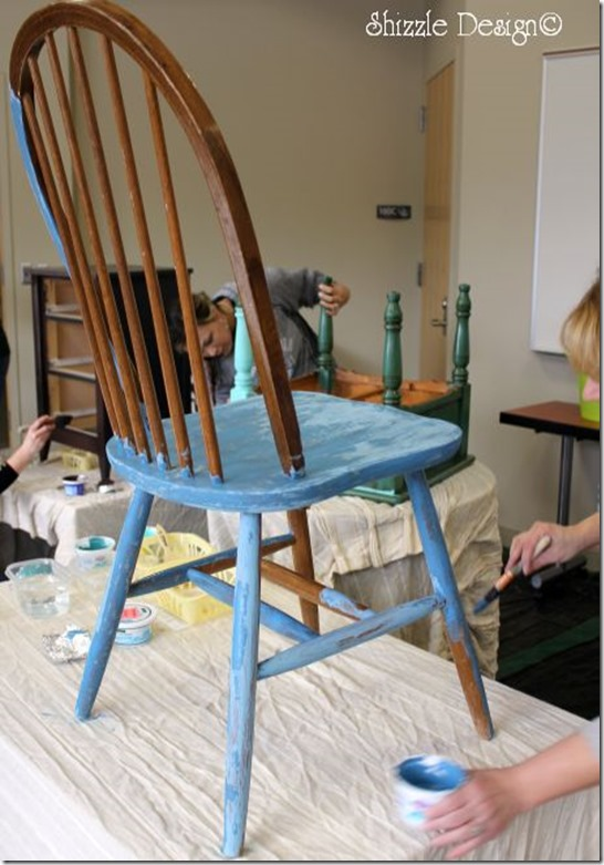 Student applying base coat of CeCe Caldwell's Blue Montana Sky at our Shizzle Style chalk clay furniture painting class taught at MSU Lansing MIchigan