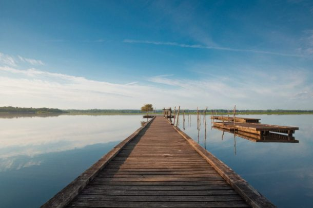 Wooden pier in a lake. Sunrise at Soustons, France
