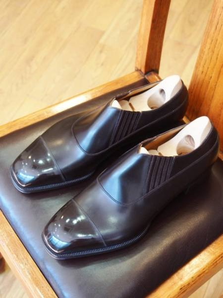 A chair, a pair of shoes, a common picture. Picture: Bolero Shoemaker