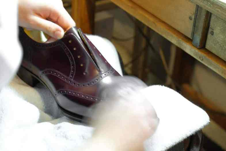 Finally the shoes are polished by hand to a nice shine.