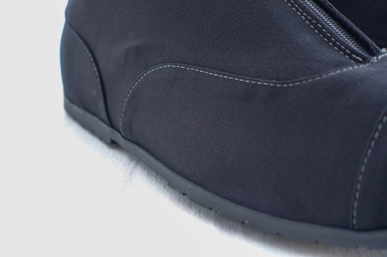 Made in a modern functional fabric with sealedseams, making them completely waterproof but breathable (which regularl galoshesisn't, butthen they do not cover the entire shoe in the same way).