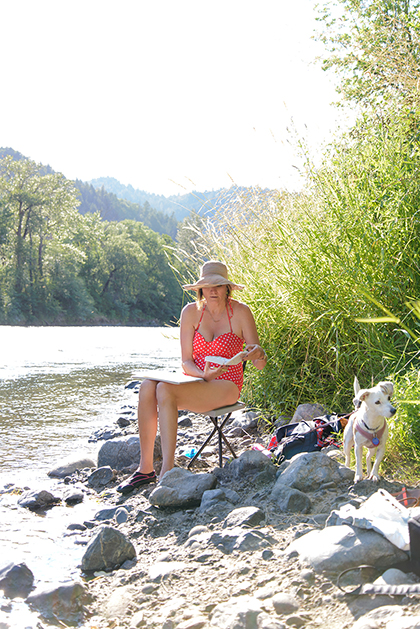 Aunt Jojo painting watercolors on the Rogue River.