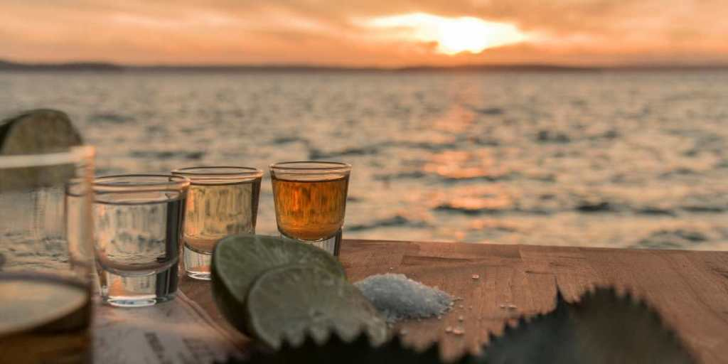 flight of tequila at sunset on the beach