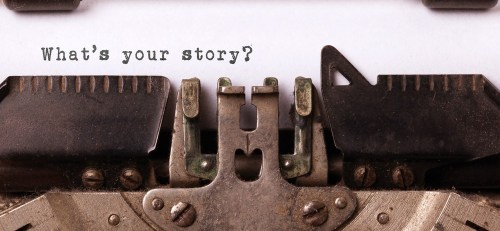 "Typewriter typing the words ""What's your story?"""