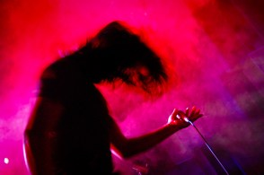 Vocalist of the band Warfaze, Mizan headbangs during one of their shows.