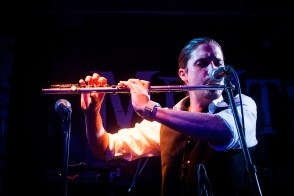 Christian from the Swedish band Starch plays his flute during a show in Dhaka.