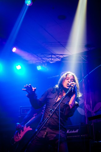 Mizan from the band Warfaze in action on stage.