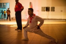 A acrobat stretching before his performance.