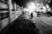 A woman on her way home on an almost empty street at night
