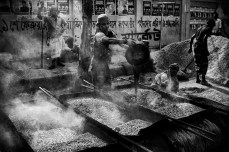 Worker, working in the process of making molten asphalt.