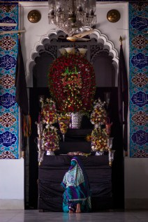 Woman offering prayers in the Hossaini Dalan.
