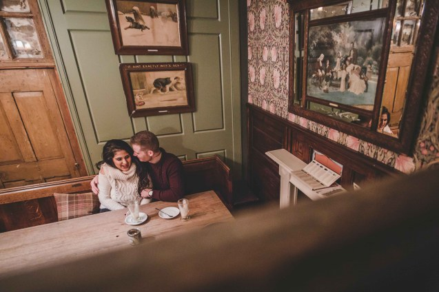Intimate engagement photos in a pub