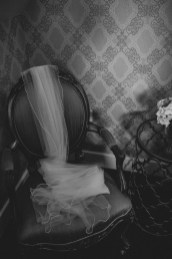 Bride's wedding veil draped on a chair