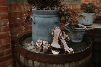 Brides shoes and flower girl shoes outside at Bassmead Manor Barns