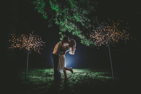 bride and groom night time kiss